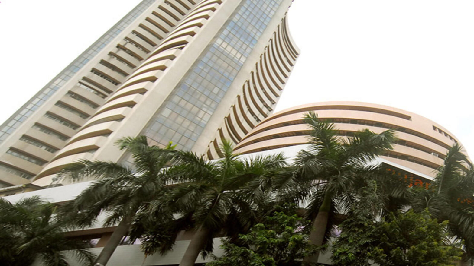 Sensex, Nifty end flat as energy gains offset losses in financials